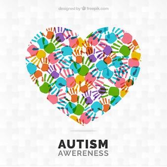 カラフルな手形と自閉症の日の背景