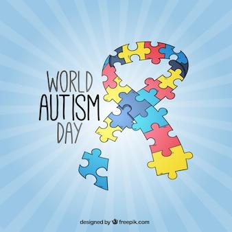 パズルのピースで作られたリボン自閉症の日の背景