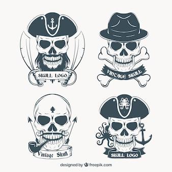 Ручной обращается логотипы черепа