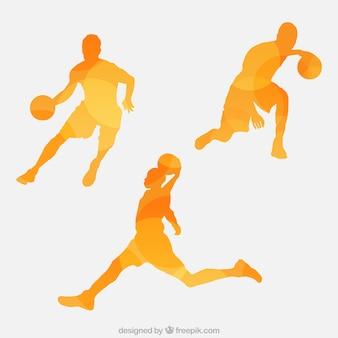 バスケットボール選手の抽象的なシルエットのセット