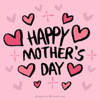母の日のための心とピンクの背景