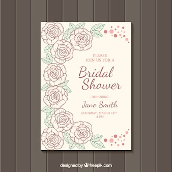 花の飾りとレトロなブライダルシャワーの招待状