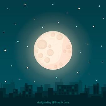大きな月と都市の景観