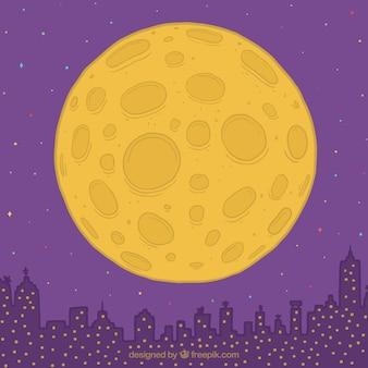 手描き月と都市の背景