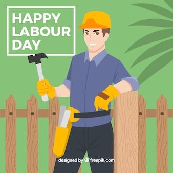 フェンスにもた労働者の背景