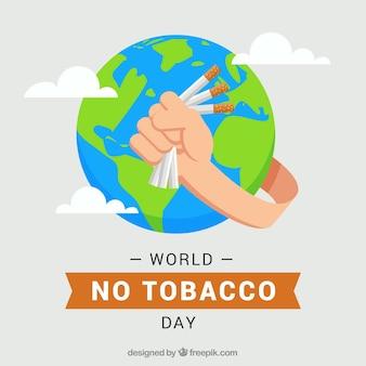 世界の背景を手で絞るタバコ