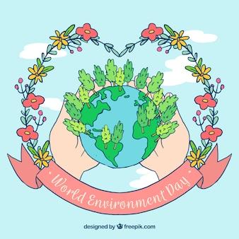 世界と手の手の背景花輪を描いた