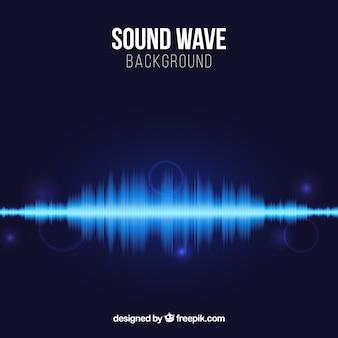 音波と光沢のある形の青い背景