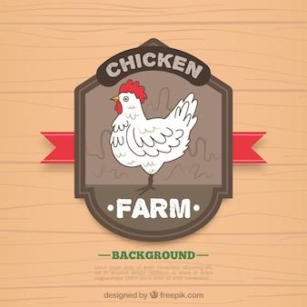 手で描かれた鶏のバッジと木製の背景