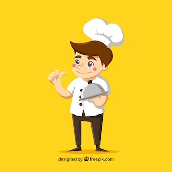 若い料理人と黄色の背景
