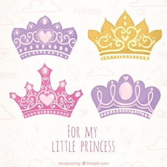 Нарисованный вручную набор четырех цветных коронок принцессы