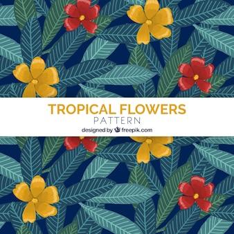 手は熱帯の花のパターンの背景を描いた