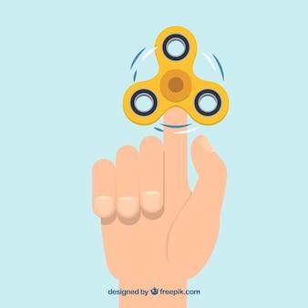 黄色のスピナーと手の背景