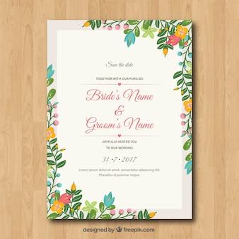 花のフレームと結婚式の招待状