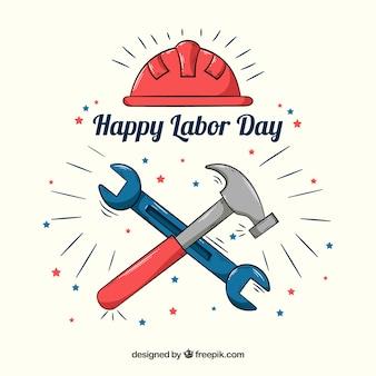 手で描かれたツールと労働日の背景