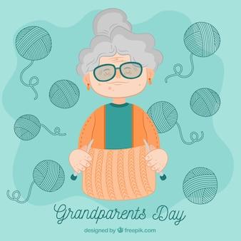手は、羊毛バンドルと祖母の背景を描いた