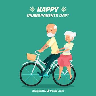 自転車の背景に乗っている祖父母のカップル