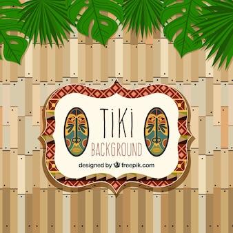 パームの葉を持つ装飾的なティキの背景