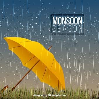 雨の背景と黄色の傘