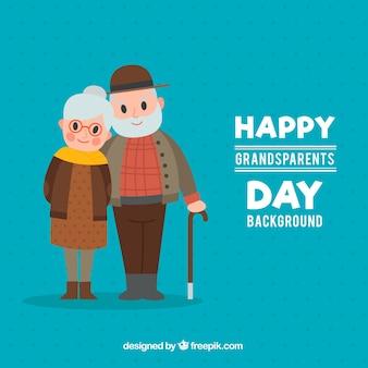 Голубой фон счастливой пары бабушек и дедушек
