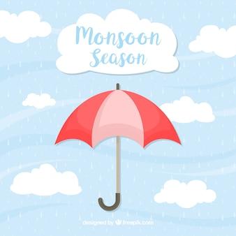 Зонтик и облачный фон