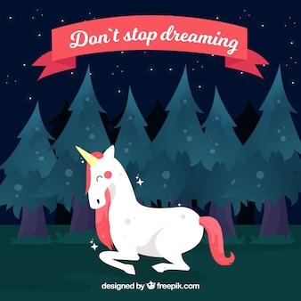 Фон единорога в лесу с фразой «не переставай мечтать»
