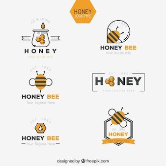フラットデザインのハチミツのロゴのコレクション