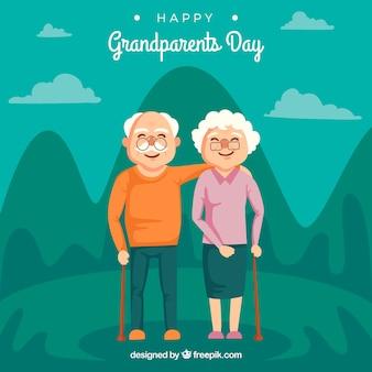 美しい風景の背景に祖父母のカップル