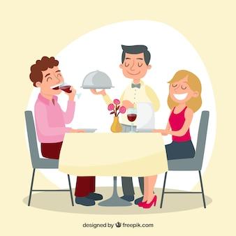 エレガントなレストランでのウェイターとカップル