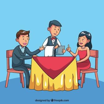 エレガントなカップルのレストランでの夕食を注文