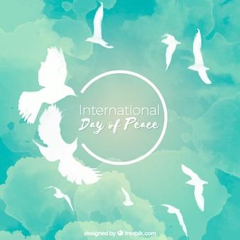 空を飛ぶクールな水彩の鳩