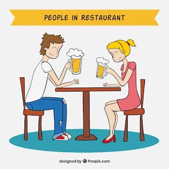 レストランのビールを飲む人