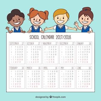 子供たちと一緒に手描きの学校のカレンダー