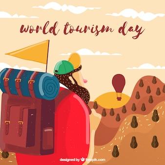 世界の観光の日、若い男は旅行を開始する