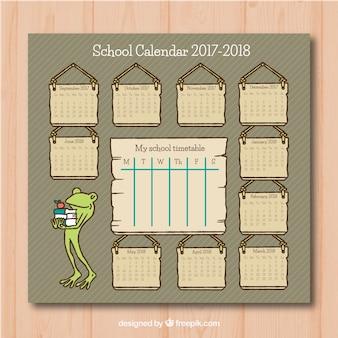 素敵なカエルと本を持つヴィンテージスクールカレンダー