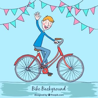 自転車で少年の挨拶の背景