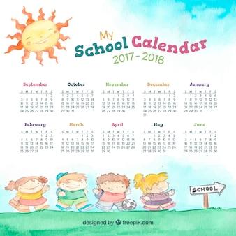 学校に行く途中の子供たちと水彩の学校のカレンダー