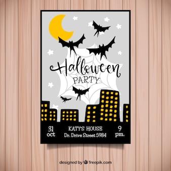 夜の街のポスターでハロウィンパーティー