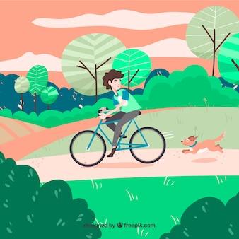 公園に自転車を持っている犬と男