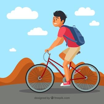 スマイリーな男が乗っている近代的な背景バイク