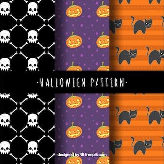 Набор из трех паттернов хэллоуина с черепами и другими элементами