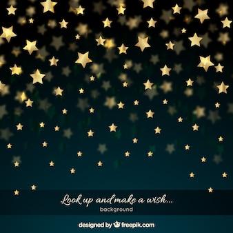 黄金の星を持つ夜の空