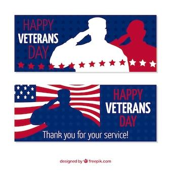敬礼の兵士と戦う退役軍人の日の旗