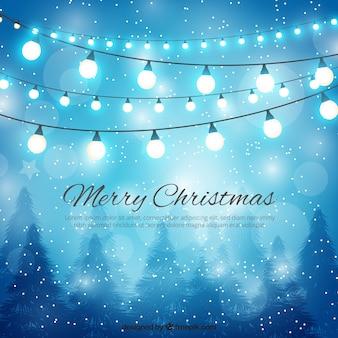 メリークリスマスとライトの背景