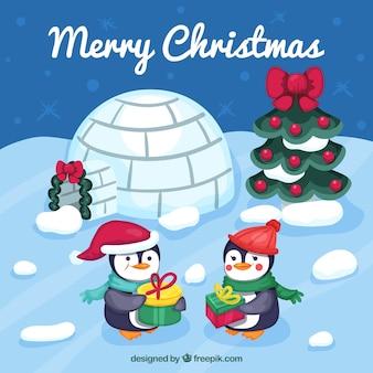 Фон с ледяным пейзажем с рождественскими пингвинами