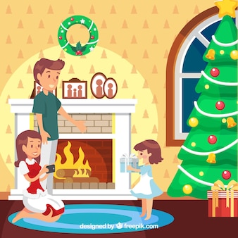 Рождественская елка у камина и семья