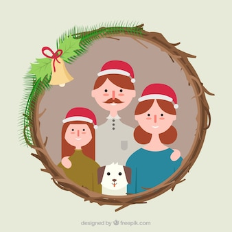 クリスマスの花輪のフレームの家族の写真