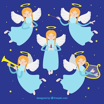 Коллекция из пяти рождественских ангелов, играющих музыку