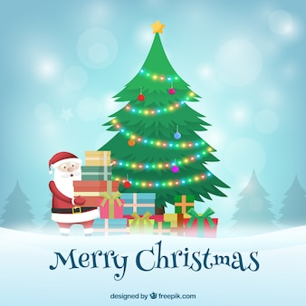 Санта-клаус оставляет подарки под елкой