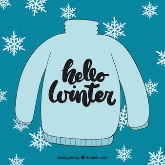 暖かい青いセーターと冬の背景